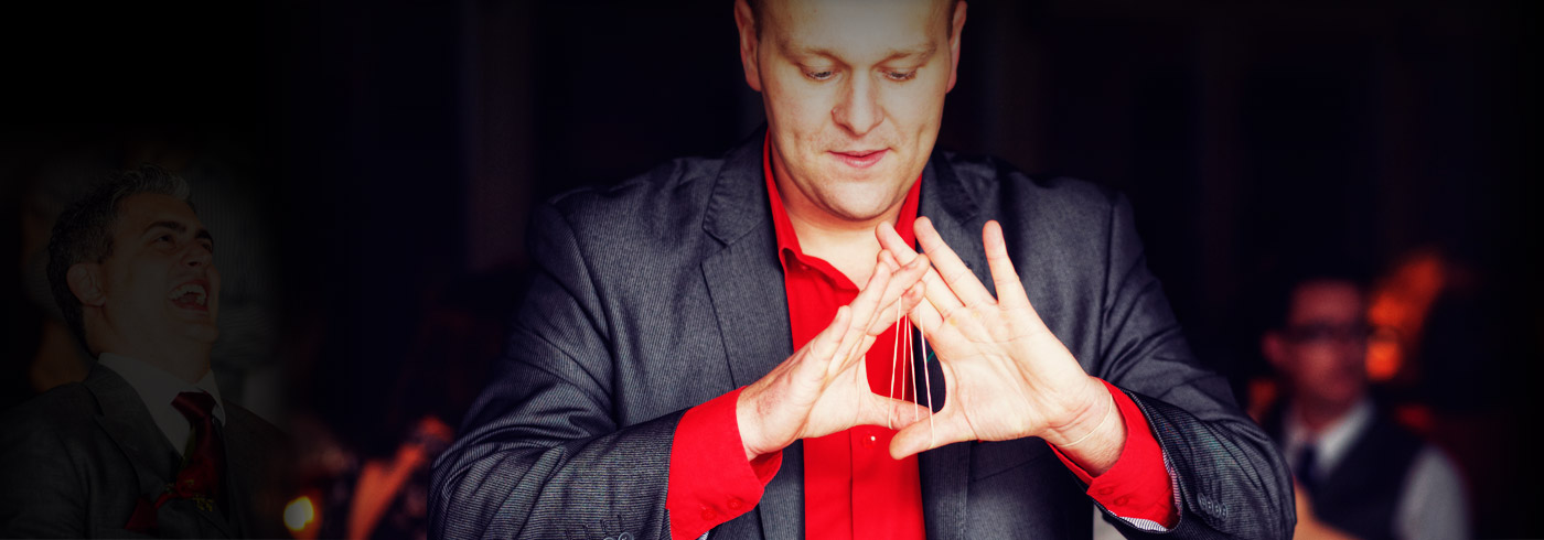 photo of magician daniel baker performing close up magic