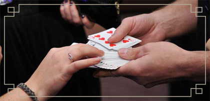 photo of a bride at a wedding taking part in a card trick with close-up magician Daniel Baker
